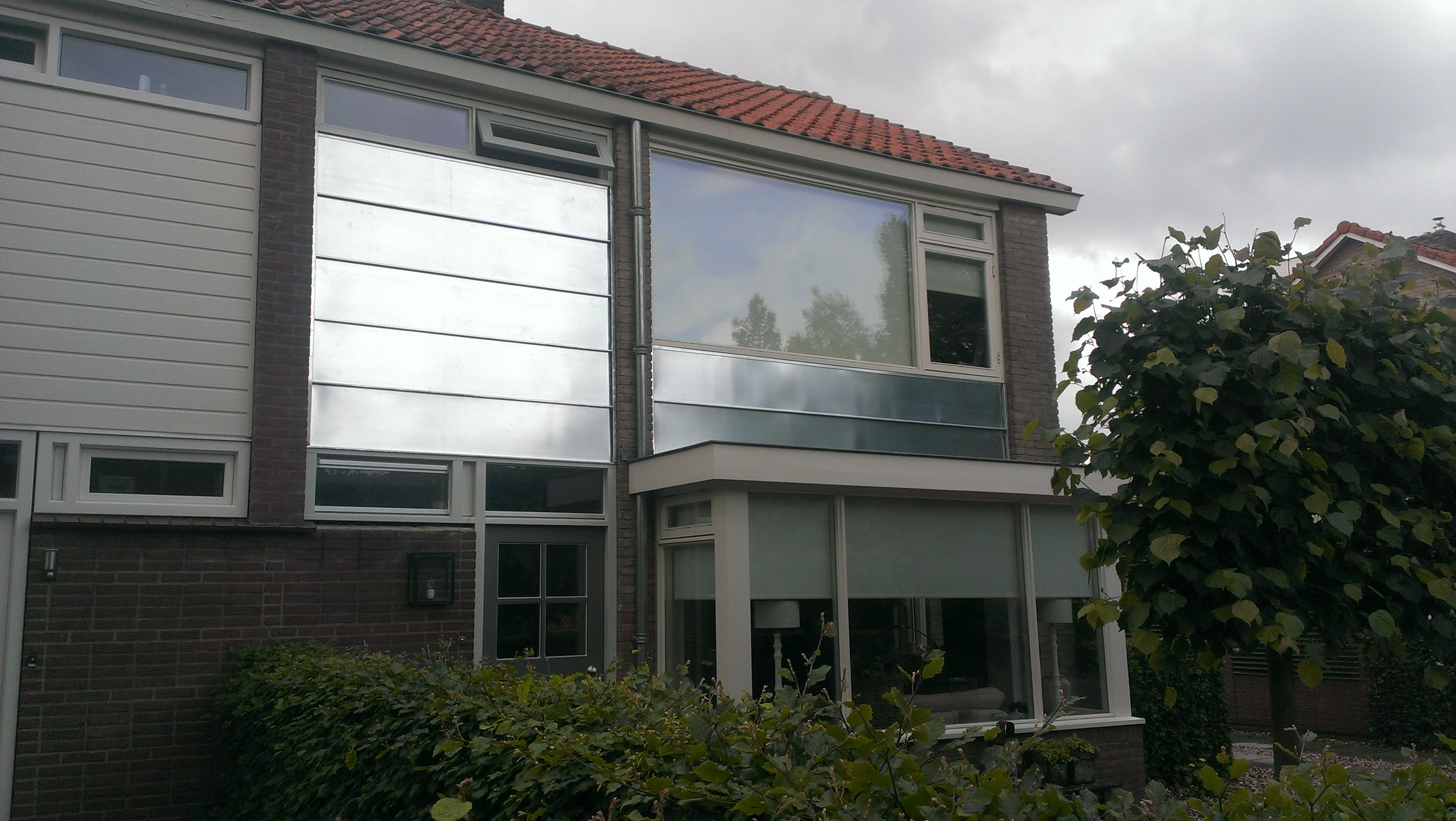 Gevel bekleed met zink, Barneveld juni 2014